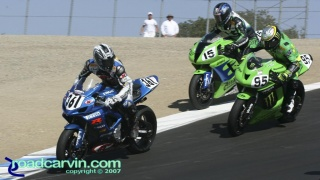 2007 AMA Supersport - Serious Racing T8: Gotta Love AMA Racing; Martin Cardenas #361 is looking at Ben Attard just out of frame making a bonzai pass on these 3 riders, while Steve Rapp #15 is taking a ride through the gravel trap and Roger Hayden #95 is trying to win the championship.