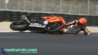 2007 Corona AMA Superstock - Santiago Villa Crash: Santiago Villa's low slide in turn 11. It's interesting how he pushes the bike away and keeps his other hand off the track.
