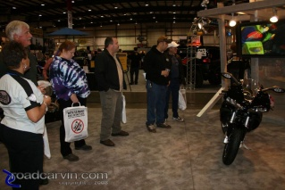 Checking out the Buell 1125R: The crowd gawks at the Buell 1125R.