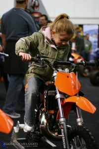 KTM kid: A future KTM rider tries out one  of the junior KTM dirt bikes.