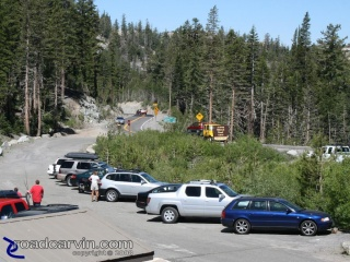 Caples Lake Parking: The parking lot at Caples Lake was full. People were enjoying fishing and hiking with their families or dogs.
