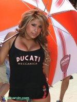 2007 Red Bull U.S. Grand Prix - Ducati Island Umbrella Girl: The Ducati Umbrella Girl striking a pose for RoadCarvin' camera.