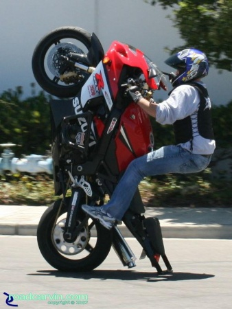 GSXR-1000 - 12 O'Clock: Draggin' the bar on this 12 o'clock wheelie. This Suzuki GSXR-1000 was nicely set up for stunt riding; large rear sprocket, crash cage and 12 o'clock bar and sounded great with a Yoshi slip on.