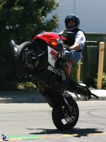 GSXR1000 - Highchair: Stunt rider on a GSXR-1000 riding a highchair wheelie. This GSXR-1000 is very nice and has a crash cage, 12 o'clock bar and Yoshi pipe.