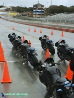 Buell 1125R Demo Bikes: Looking up the pit lane with the Buell 1125R demo bikes lined up.
