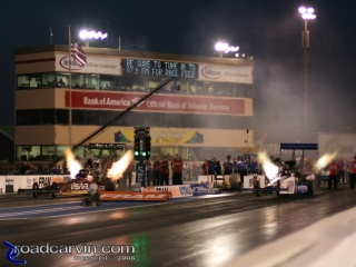 Night Fire: JR Todd and Steve Torrence (far lane) light up the night.