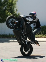 Raven R6 - Standup Wheelie I: Raven R6 Yamaha rider doing a high standup wheelie. The bike was really clean and had a crash cage and frame sliders.