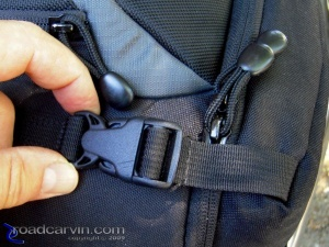 Access Flap Strap and Clasp: Access flap retention strap and clasps, with zippers tucked in behind the strap to help prevent unintentional opening.